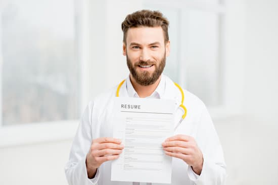 Doctor in uniform holding resume for job hiring in the white interior